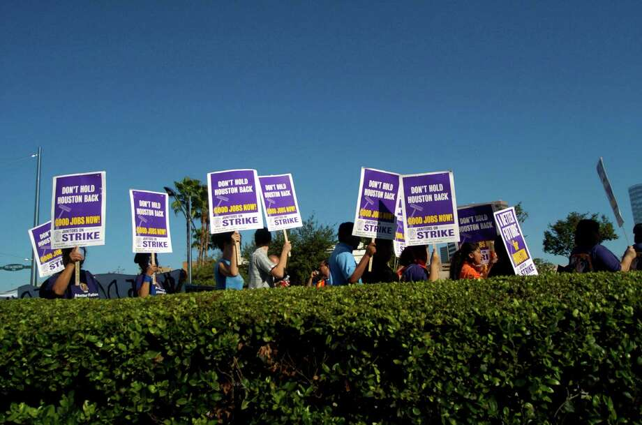 Hundreds of Houston area janitors and supporters marched down Post Oak Rd. during a Service Employees International Union (SEIU) march and rally that began at Grady Park in the Galleria, Saturday, Oct. 28, 2006. About 4,700 low-wage janitors in Houston have formed a union with SEIU and an additional 600 janitors will soon join in their fight for fair wages and benefits. (Johnny Hanson for the Houston Chronicle) Photo: Johnny Hanson, Freelance / Freelance