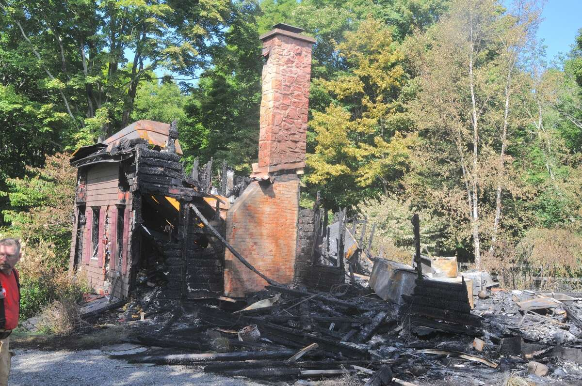 Remains of a fire on Ford Road in Chatham that is believed to have killed a man in his 80s Sept. 5, 2016. (Lance Wheeler)