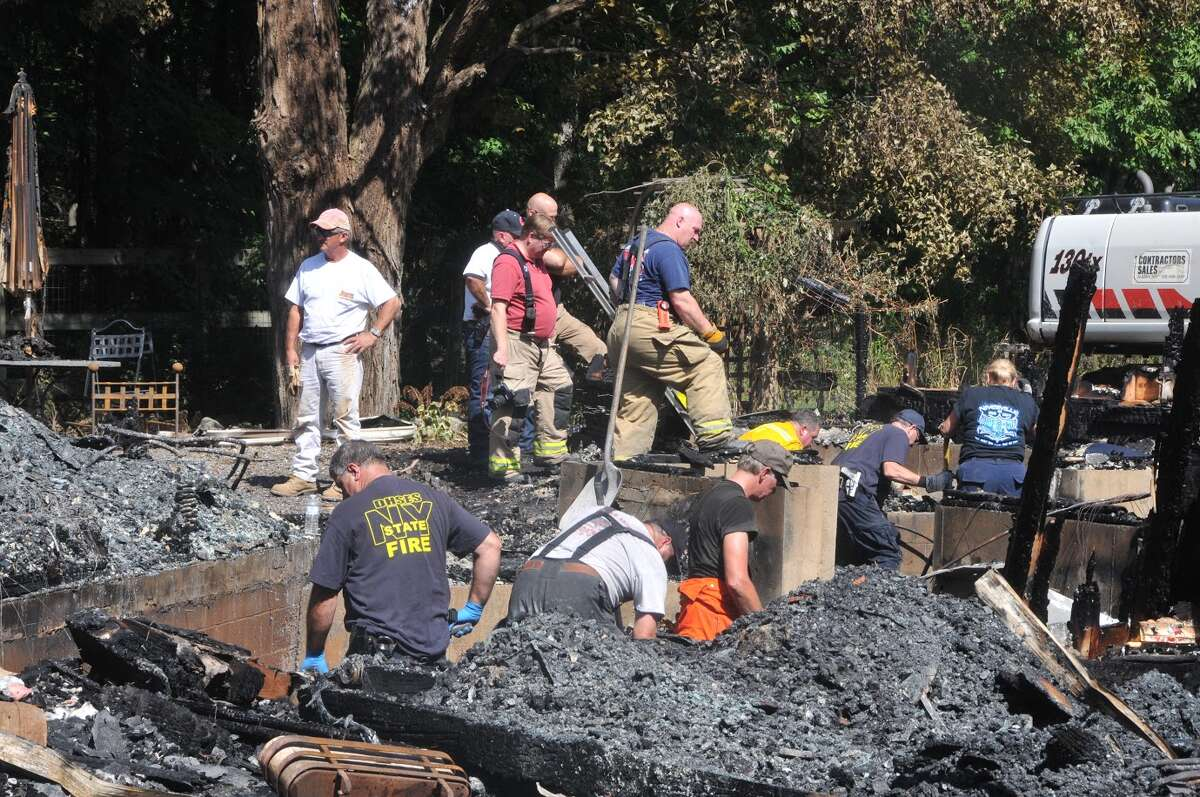 Fire investigators go through rubble of a fatal fire in Chatham, Columbia County Monday Sept. 5, 2016. (Lance Wheeler)