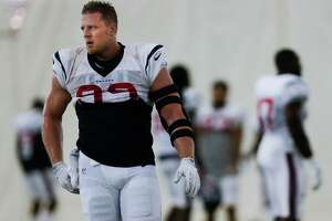 After back surgery earlier this summer to repair a herniated disc, Houston Texans defensive end J.J. Watt (99), left, returns to practice at the Houston Methodist Training Center Monday, September 5, 2016 in Houston.