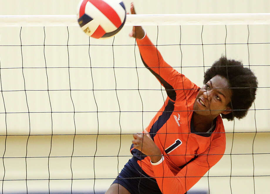 Brandeis' Jordan Jefferson goes up for a kill shot over Johnson's Meghan Parker during their season-opening volleyball match at Taylor Field House on Aug. 10, 2015. Photo: Marvin Pfeiffer /San Antonio Express-News / Express-News 2015