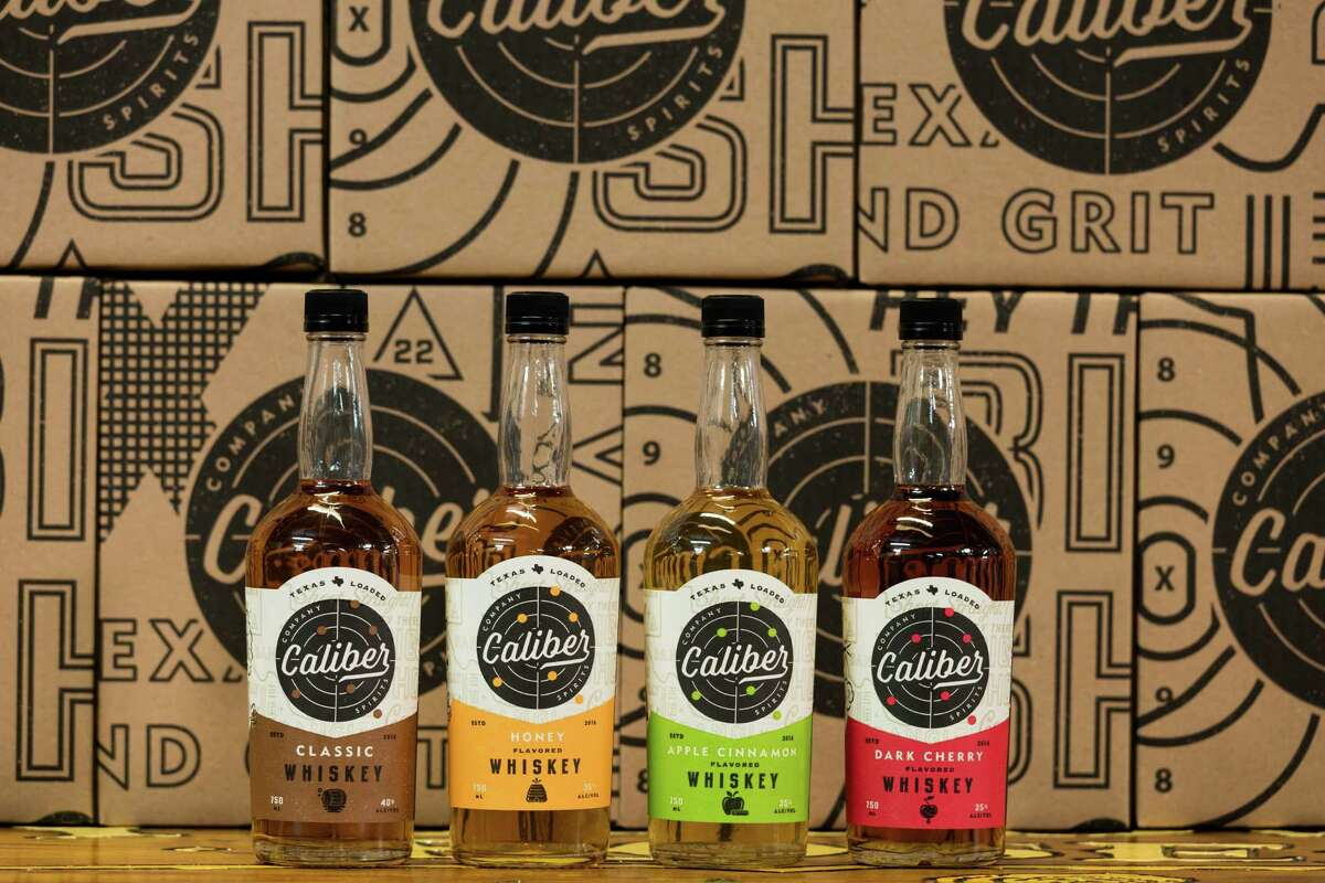 Caliber Company Spirits' new line of flavored whiskeys includes Classic, Honey, Apple Cinnamon and Dark Cherry.
