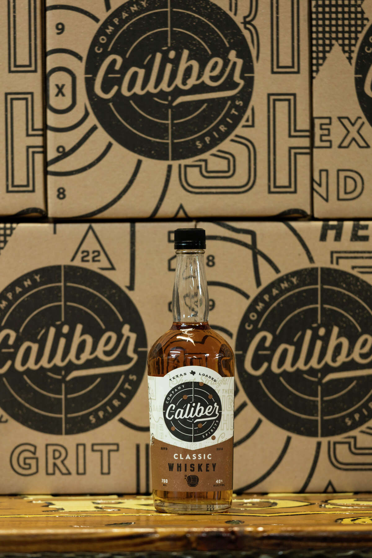 Caliber Company Spirits, a new brand from Yellow Rose Distilling, has created a new line of flavored whiskeys. Shown: Classic whiskey with flavors of vanilla bean, honey and oak.