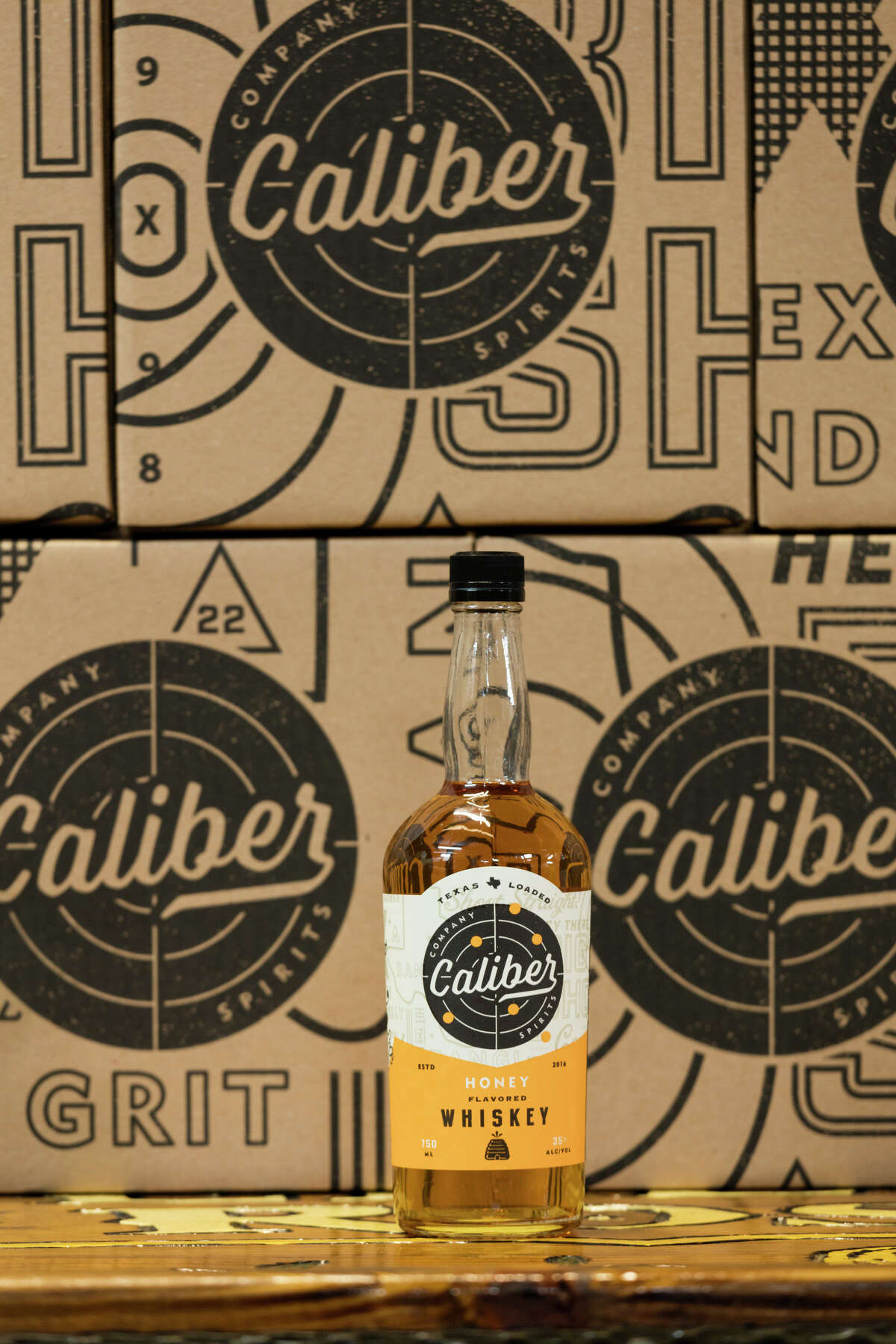 Caliber Company Spirits, a new brand from Yellow Rose Distilling, has created a new line of flavored whiskeys. Shown: Honey whiskey infused with notes of honey and maple syrup.