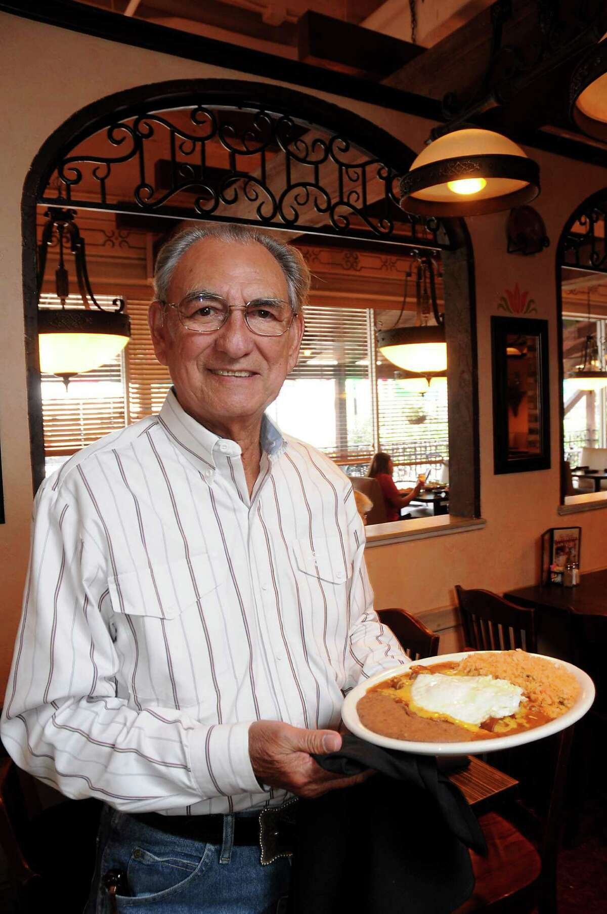 Raul Molina Jr. with a plate of cheese enchiladas and a fried egg at Molina's Cantina on Bellaire Tuesday Aug. 30, 2016. (Dave Rossman Photo)