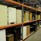 Bedroom Dressers And Night Stands Line One Side Of A Long Row Of Industrial  Shelving At