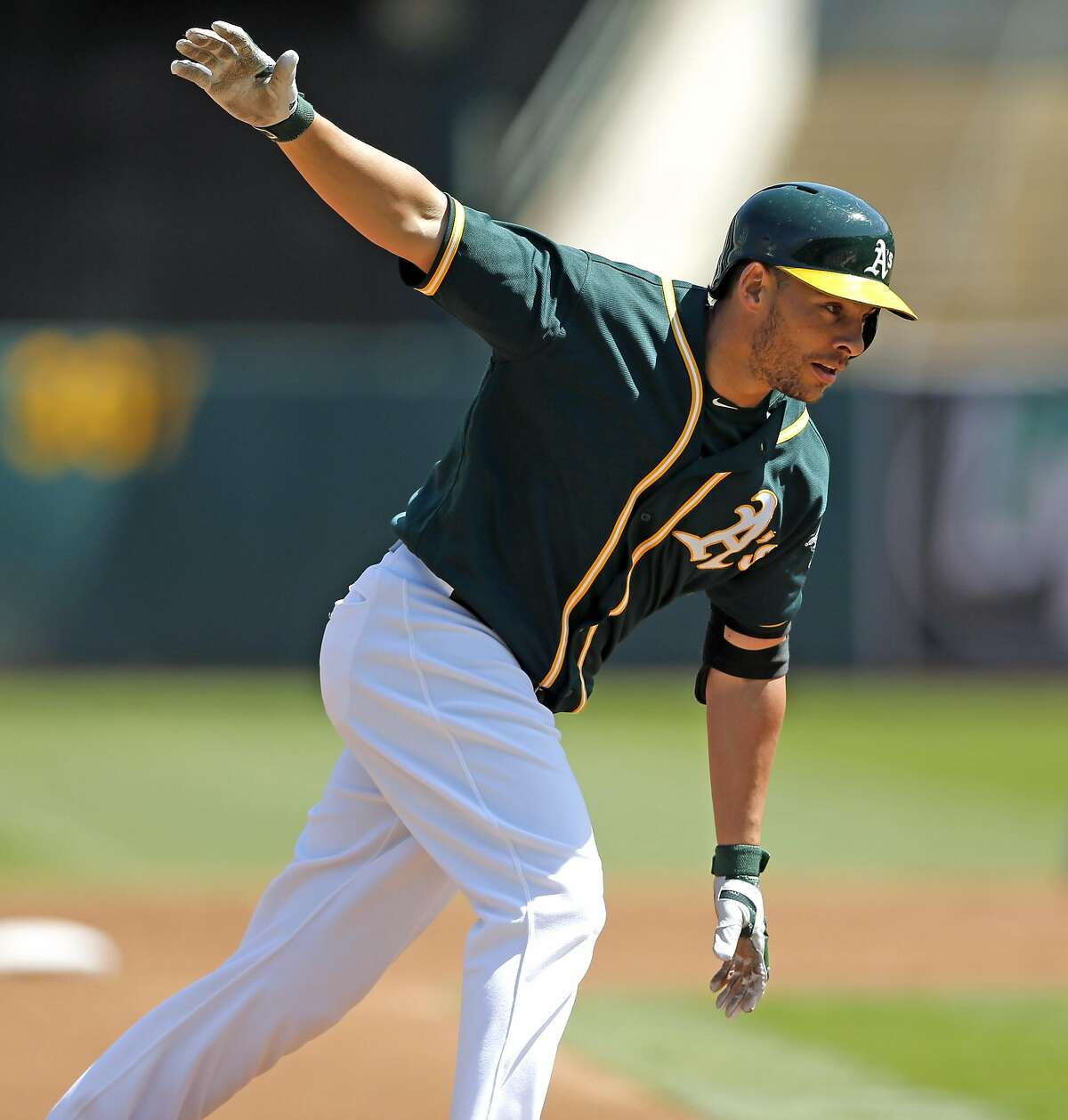 Oakland Athletics' Danny Valencia rounds the bases after his 2-run home run against Los Angeles Angels during MLB game at Oakland Coliseum in Oakland, Calif., on Monday, September 5, 2016.