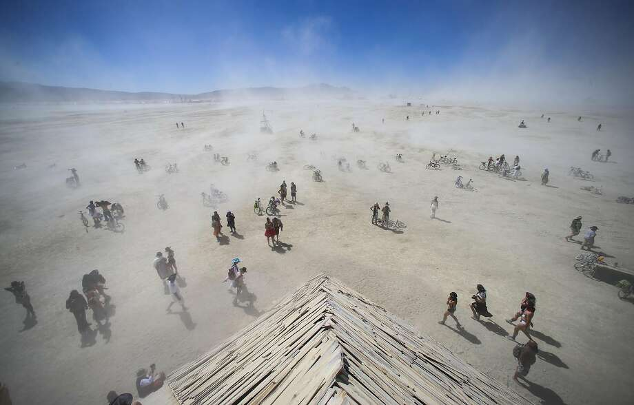 In this 2016 photo, attendees approach the Catacomb of Veils art installation as dust kicks up along the playa during Burning Man at the Black Rock Desert north of Reno, Nev. (Chase Stevens/Las Vegas Review-Journal via AP) Photo: Chase Stevens, Associated Press