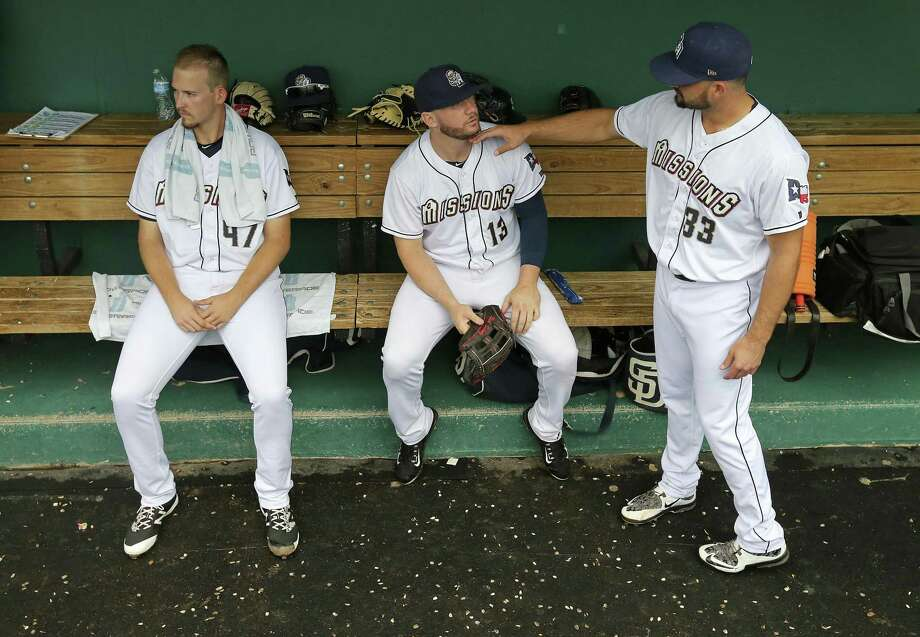 San Antonio Missions pitcher Jerry Keel (from left), right fielder Nick Schulz and pitcher Trey McNutt joke while in the dugout before the game with the Corpus Christi Hooks Sunday Sept. 4, 2016 at Wolff Stadium. Photo: Edward A. Ornelas, Staff / San Antonio Express-News / © 2016 San Antonio Express-News