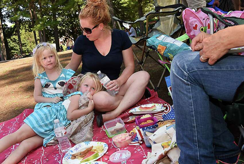 Shelby Parsons of Charlton has a picnic on the lawn with her twin 4 yr-old daughters Claire, sitting up, and Evelyn, and her mother Lynn Ceraldi, right, of Charlton as they enjoy the United States Navy Band Northeast Ceremonial Band perform a concert highlighting musical selections meant to inspire patriotism during a free Labor Day concert at Saratoga Performing Arts Center on Monday, Sept. 5, 2016 in Saratoga Springs, N.Y. (Lori Van Buren / Times Union)