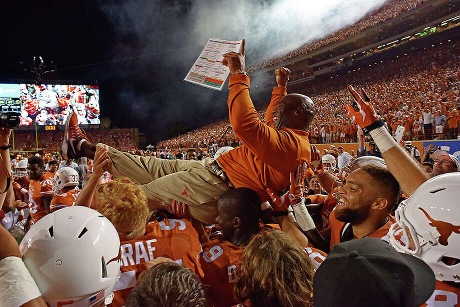 Texas head coach Charlie Strong is carried by players after defeating Notre Dame in double overtime of an NCAA college football game, Sunday, Sept. 4, 2016, in Austin, Texas. (Gabriel Lopez/The Daily Texan via AP) Photo: Gabriel Lopez, MBR / Gabriel Lopez