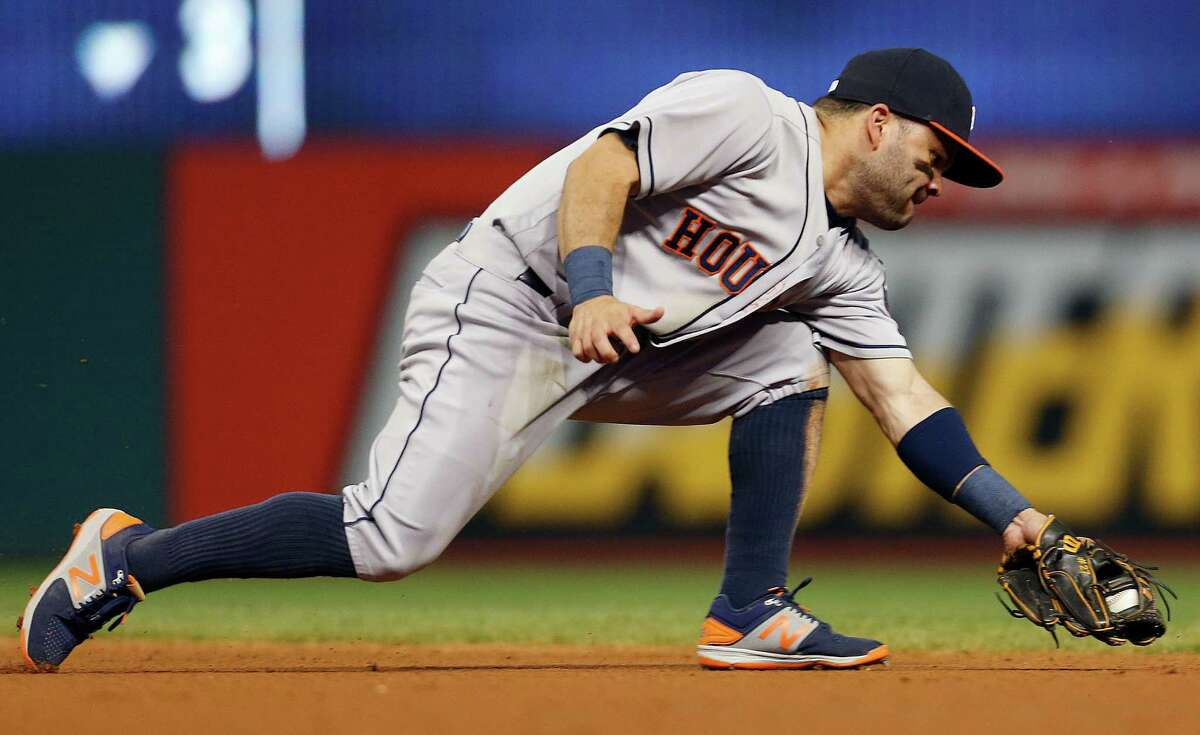 Houston Astros' Jose Altuve fields the ball and starts a double play on a ball hit by Cleveland Indians' Francisco Lindor during the fifth inning of a baseball game Monday, Sept. 5, 2016, in Cleveland. (AP Photo/Ron Schwane)
