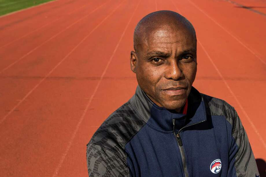 Carl Lewis poses for a portrait at the University of Houston track on Wednesday, Feb. 18, 2015, in Houston. The former UH track star and nine time Olympic gold medalist has joined the Cougars' track and field program as an assistant coach, and will help with sprints and jumps.( Brett Coomer / Houston Chronicle ) Photo: Brett Coomer, Staff / © 2015 Houston Chronicle