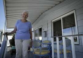 """Lois Requist, in her new senior trailer park in Benicia, Calif., on Thursday, September 1, 2016. Requist admits that she received some rather  unfavorable remarks from friends after she sold her home and chose to buy her """"tindominium."""""""