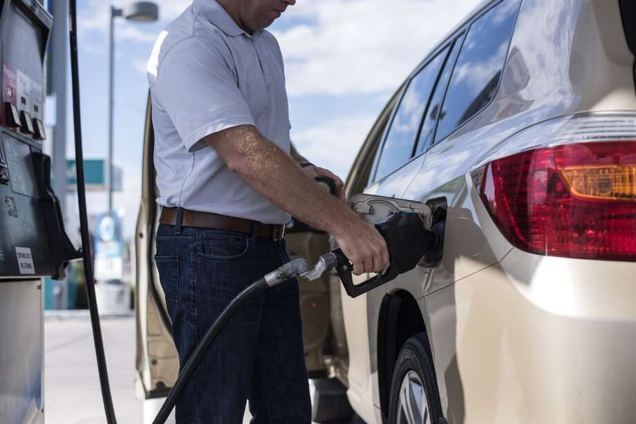 Concerns about a trade war between the U.S. and China eroded crude oil prices, which pushed down the price of gasoline in Houston and across the country for the first time in weeks.