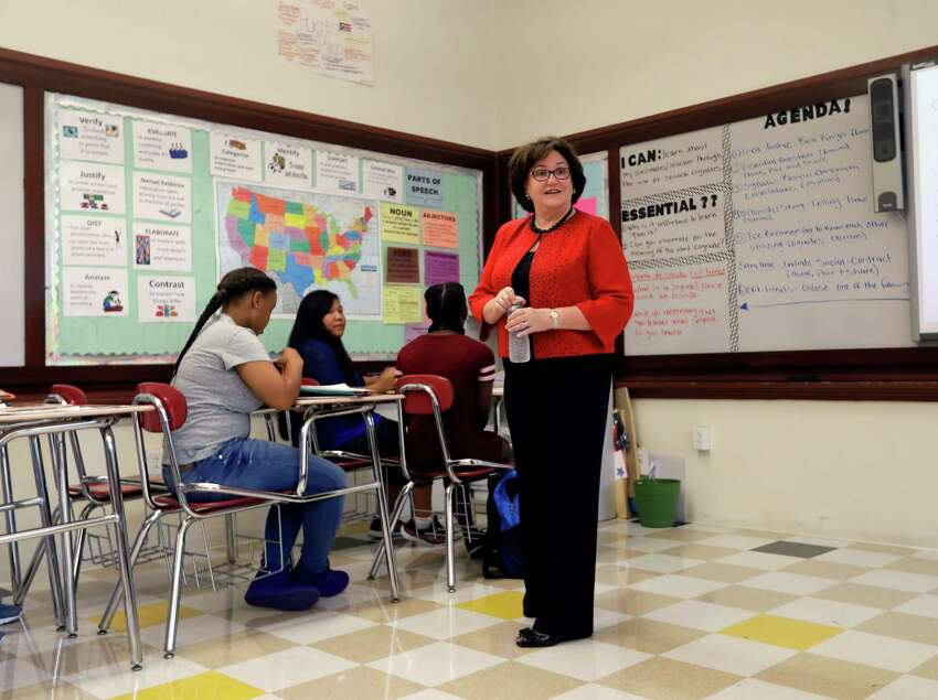 New York State Education Commissioner MaryEllen Elia talks to students in an eighth grade Spanish class on the first day of school at William Hackett Middle School, Tuesday, Sept. 6, 2016, in Albany, N.Y. New York's 2.7 million students and 207,000 teachers go back to work this week. Most students in Buffalo also return to class Tuesday, while students in the Syracuse and Rochester districts go back Wednesday. New York City students have until Thursday to enjoy summer vacation. (AP Photo/Mike Groll)