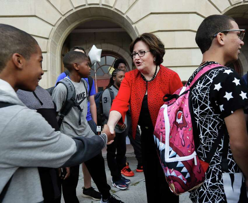 New York State Education Commissioner MaryEllen Elia greets students at William Hackett Middle School on the first day of school, Tuesday, Sept. 6, 2016, in Albany, N.Y. New York's 2.7 million students and 207,000 teachers go back to work this week. Most students in Buffalo also return to class Tuesday, while students in the Syracuse and Rochester districts go back Wednesday. New York City students have until Thursday to enjoy summer vacation. (AP Photo/Mike Groll)