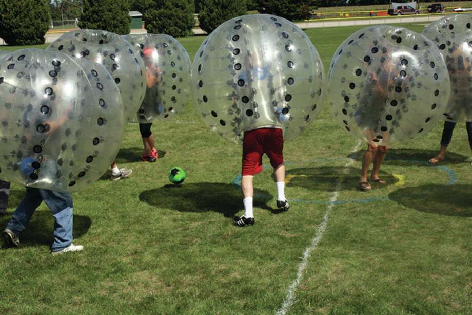 The Knockerball Soccer Tournament is introduced at the Elkton AutumnFest for the first time on Saturday. The object of the game is to play soccer while wearing a protective see-through ball-like structure that weighed about 40 pounds. The games were much slower than regular soccer, but they seemed to be much more fun for the audience to watch. Afterward, adult players admitted the game took much more effort than they expected.