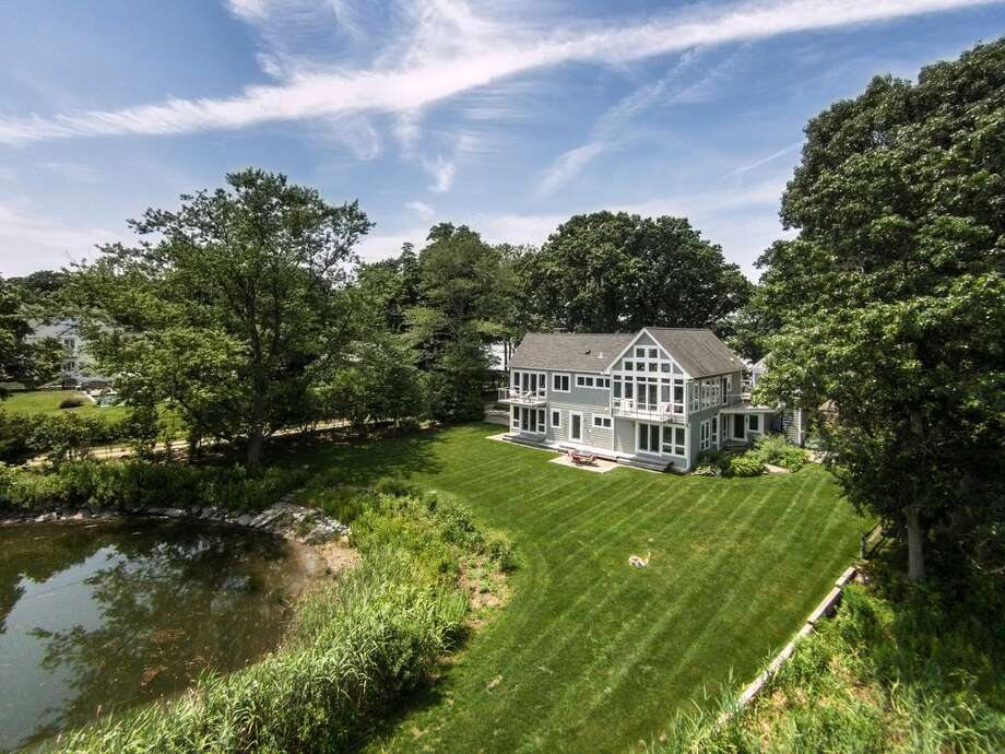 52 Shorehaven Rd, Norwalk, CT 06855  3 beds 3 baths 3,131 sqft  Open House: 9/11 2p.m. - 4p.m. Features: Located on private Canfield Island, cathedral ceilings, separate office/artist studio, panoramic water views from every room View full listing on Zillow Photo: Zillow