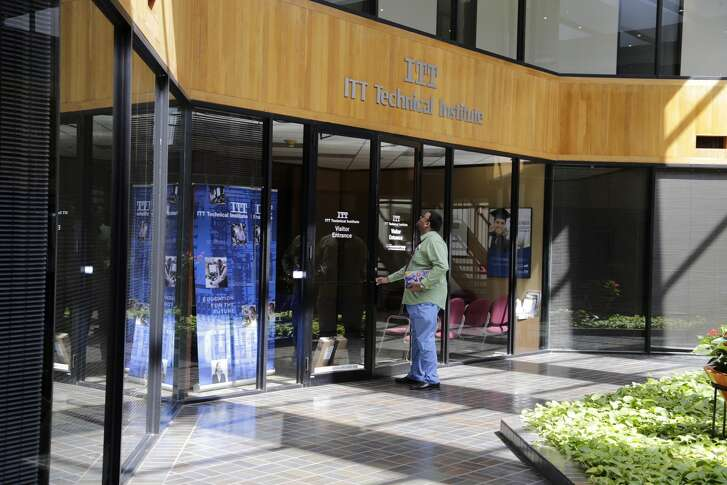 A student arrives to find the doors locked at the ITT Technical Institute campus in the 2900 block of South Gessner Road in Houston, Texas on Sept. 6, 2016. Nationwide, ITT Educational Services shut down all campuses after the U.S. Department of Education forbade the school system from taking in students who received federal financial aid.