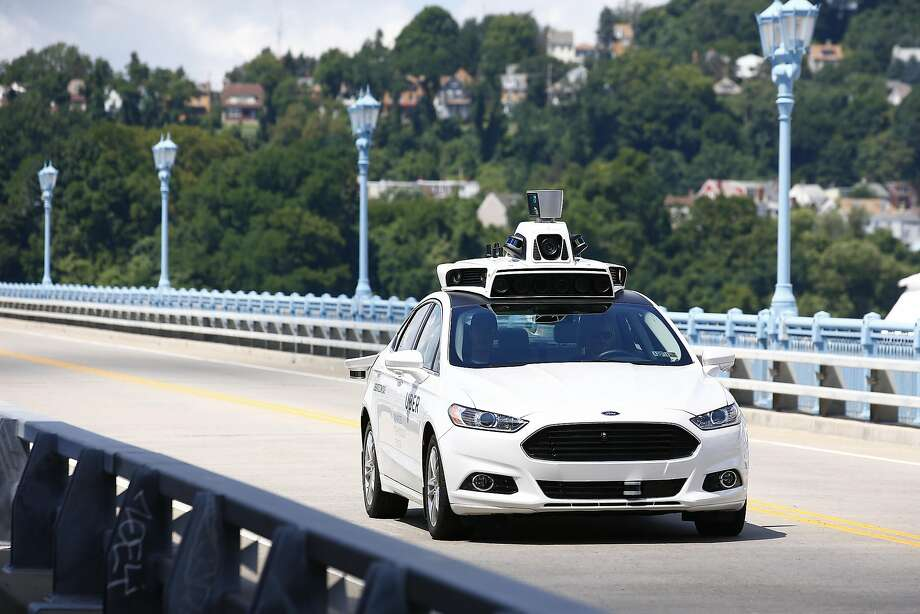 Uber employees test the self-driving Ford Fusion hybrid cars in Pittsburgh, Pa on Thursday, Aug. 18, 2016. (AP Photo/Jared Wickerham) Photo: Jared Wickerham, Associated Press