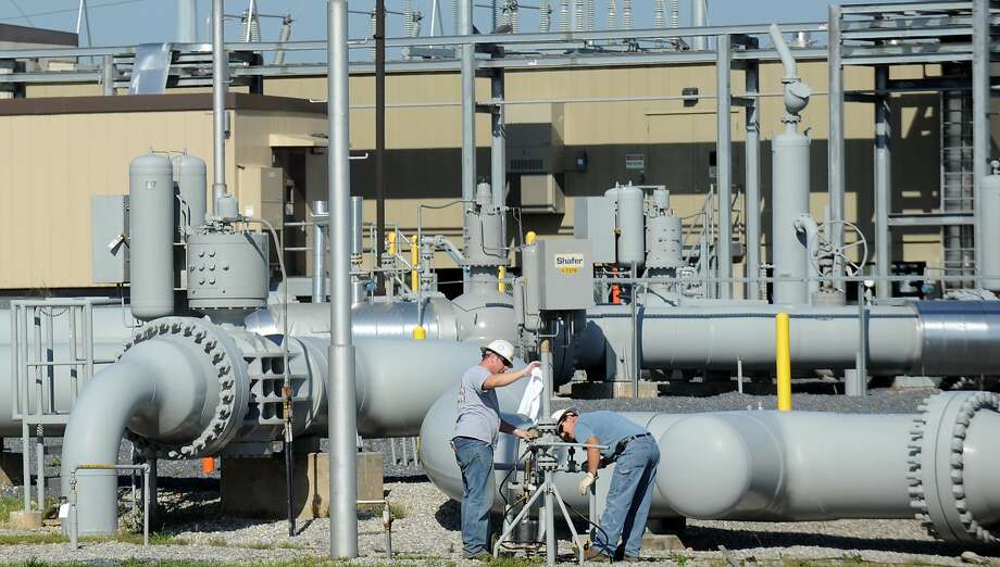 FILE - In this 2011 file photo, workers make minor repairs on the pipeline hub run by Spectra Energy Corp. in Guilford, Pa. Canada's Enbridge is buying Houston-based Spectra Energy. Photo: Andrew Russell, Associated Press