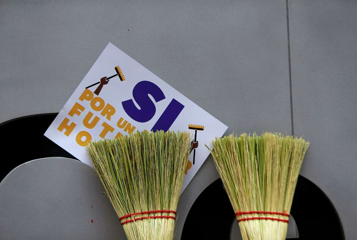 Janitors, supporters and SEIU members and staff rally in front of One Allen Center, a building members of their union cleans, in advance of a vote for a new contract with the contractors who employ them, Wednesday, May 25, 2016, in Houston. ( Mark Mulligan / Houston Chronicle )