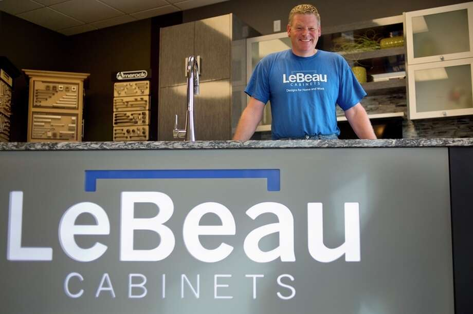 EJ LeBeau is all smiles because LeBeau Cabinets was named the number one place to buy kitchen cabinets in this year's Readers' Choice awards.