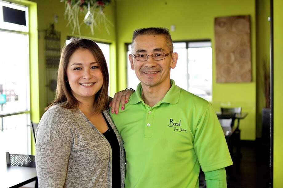 Two of the owners of Basil Thai Bistro, father and daughter Sami Ung, left, and Hugh Miller. / Midland Daily News