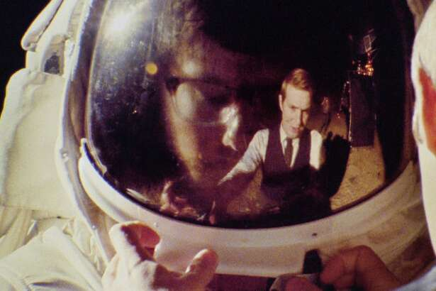 """Matt Johnson as CIA analyst Matt Johnson reflected in the helmet worn by Owen Williams in """"Operation Avalanche,"""" opening at Bay Area theaters on Friday, September 23. Photo courtesy of Lionsgate Premiere."""