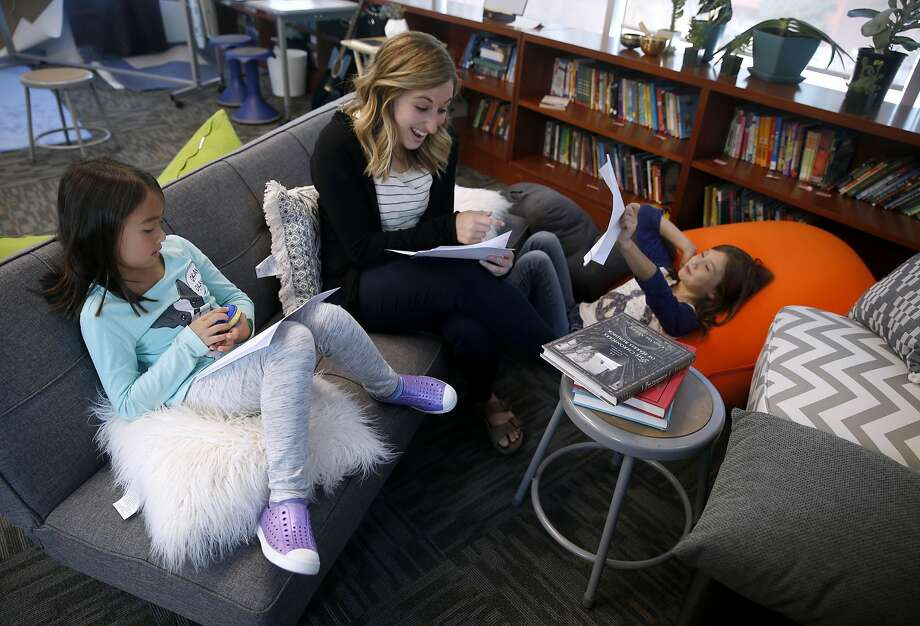 Teacher Emily Greenberg works with upper elementary students in the English language arts class at the Yerba Buena campus, which opened last month in San Francisco. Photo: Paul Chinn, The Chronicle