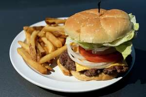 A popular meal at the Boulevard Lounge is a 'Bully Burger' and fries.