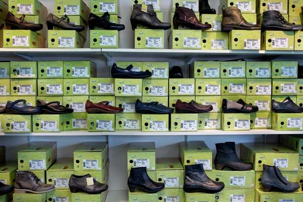 Shoes are shown on display at Circle Quality Shoes.