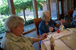 ERIN KIRKLAND | ekirkland@mdn.net Residents Nancee Most, 85, left, and Marian Reinke, 89, right work on an arts and crafts project at King's Daughters Home.