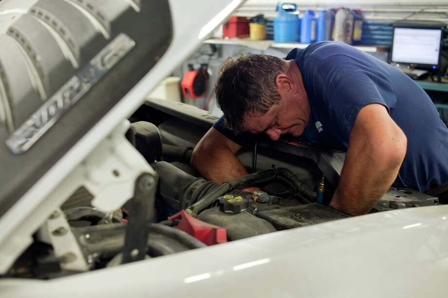 Garber Chevrolet Master Mechanic Steve Grzegorczyk services a transmission on Thursday. Garber won best auto dealership, used auto dealership and auto detailer in the Midland Daily News Readers' Choice Awards.