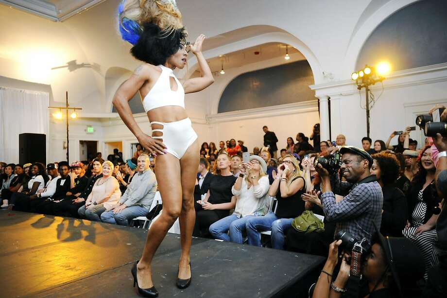 Model Shonta Jones strikes a pose while working the runway in front of a packed house during a fashion show celebrating Queer Fashion Week in Oakland, CA, on Friday, April 17, 2015. The event returns Sept. 28-Oct. 2. Photo: Michael Short, Special To The Chronicle