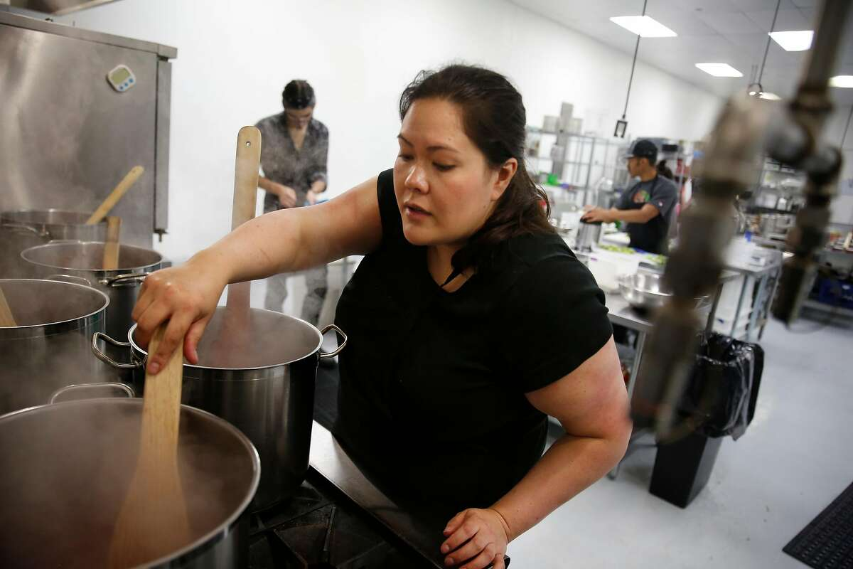 Gillian Reynolds, Jamnation founder, cooks jam on a stove at a South Basin Partners commercial kitchen on Monday, September 5, 2016 in San Francisco, California.