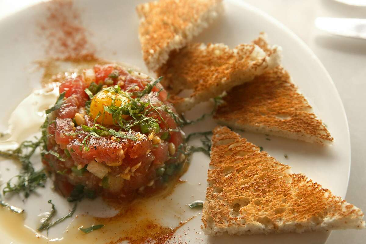 George's Ahi Tartare--pine nuts, asian pear, jalapeno-fresno chile, mint, garlic, habanero infused sesame oil--seen at new restaurant Fish & Farm in the Embarcadero in San Francisco, California, on Wednesday, June 10, 2015.