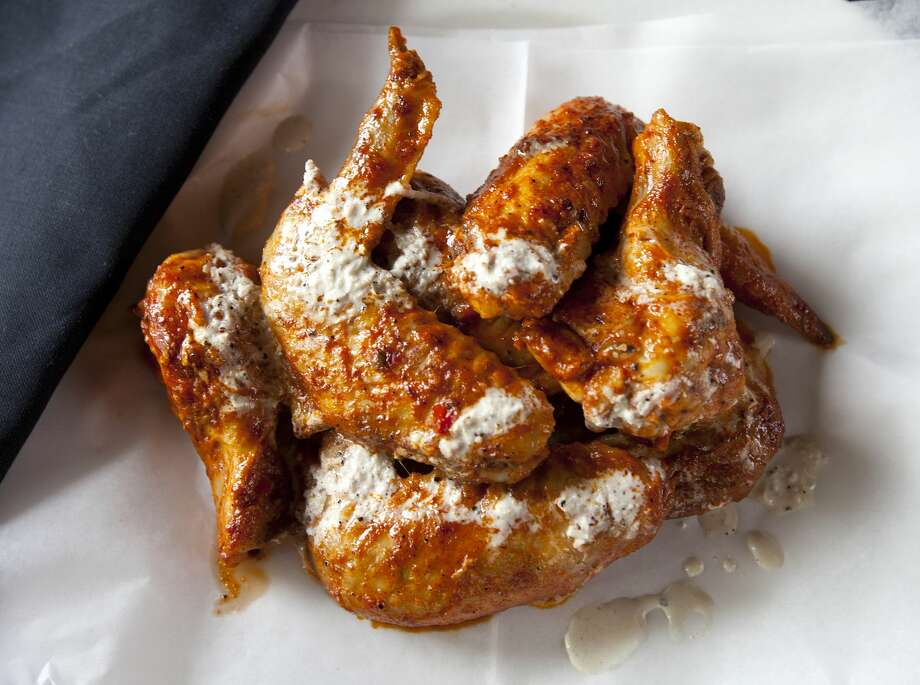 Smoked chicken wings served with Alabama white sauce are shown here. Expect the sauce to be one of the bigger food trends within the next few months, in fall 2016. Photo: The Washington Post/The Washington Post/Getty Images
