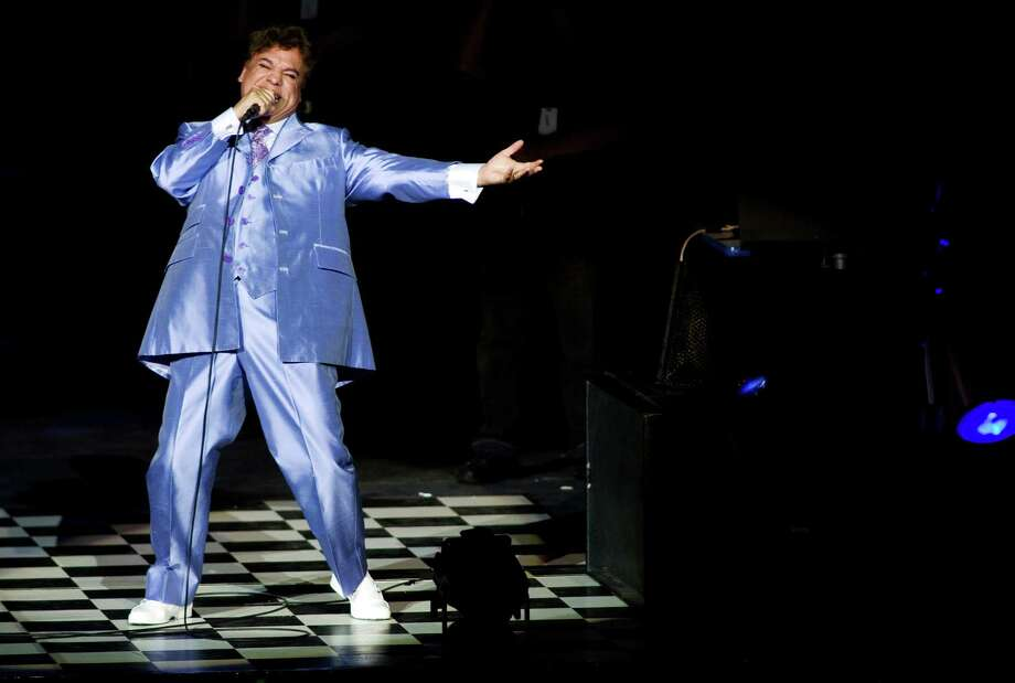 In this 2009 file photo, Mexican singer Juan Gabriel performs in a concert in Guadalajara, Mexico. Gabriel was Mexico's leading singer- songwriter and top-selling artist with sales topping 100 million albums. His cultural importance was significant. Photo: Carlos Jasso /Associated Press / AP2009