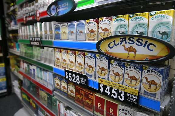Packs of cigarettes at the Cigarettes R Cheaper store in San Pablo, Calif. on Tues. Sept. 6, 2016. California's proposition 56, the cigarette initiative is passed would add $2 to a pack of cigarettes which would go to health-care programs, smoking prevention and research.