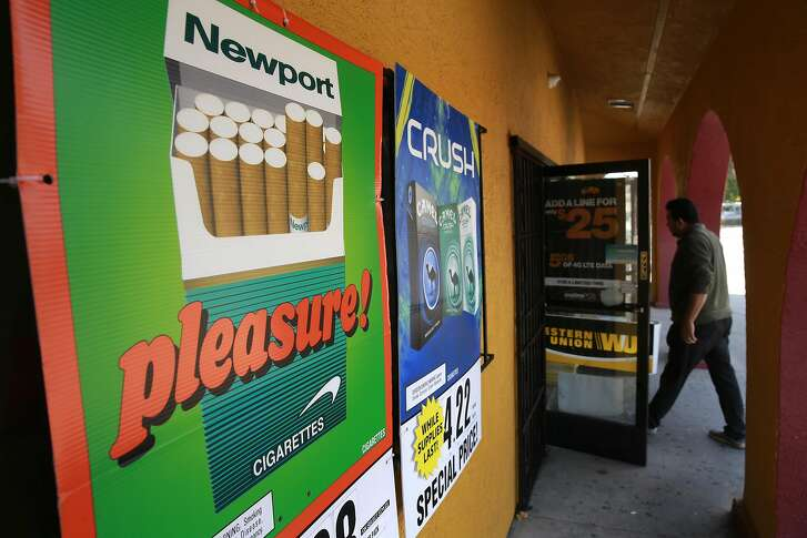 Cigarette ads outside the Mercado La Hacienda market in San Pablo, Calif. on Tues. Sept. 6, 2016. California's proposition 56, the cigarette initiative is passed would add $2 to a pack of cigarettes which would go to health-care programs, smoking prevention and research.