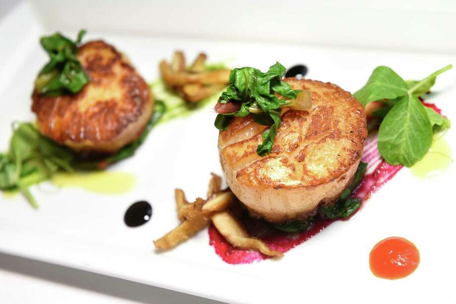 Seared Diver Scallops with corn puree, chorizo, Israeli couscous and Australian blood orange segments on Thursday, Sept. 1, 2016, at The Inn at Erlowest in Lake George, N.Y. (Cindy Schultz / Times Union) Photo: Cindy Schultz / Albany Times Union