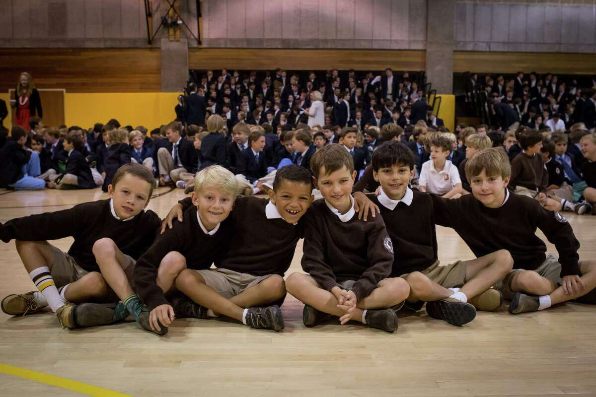 Second-graders Chase Nook, Landon O'Hara, Caden Tate, Harry Saunders, Oliver Subramaniam, Jack Wendell gather at opening exercises for Brunswick's 114th school year. Ceremonies were held at Dann Gymnasium on Brunswick's Edwards Campus on King Street Thursday morning.