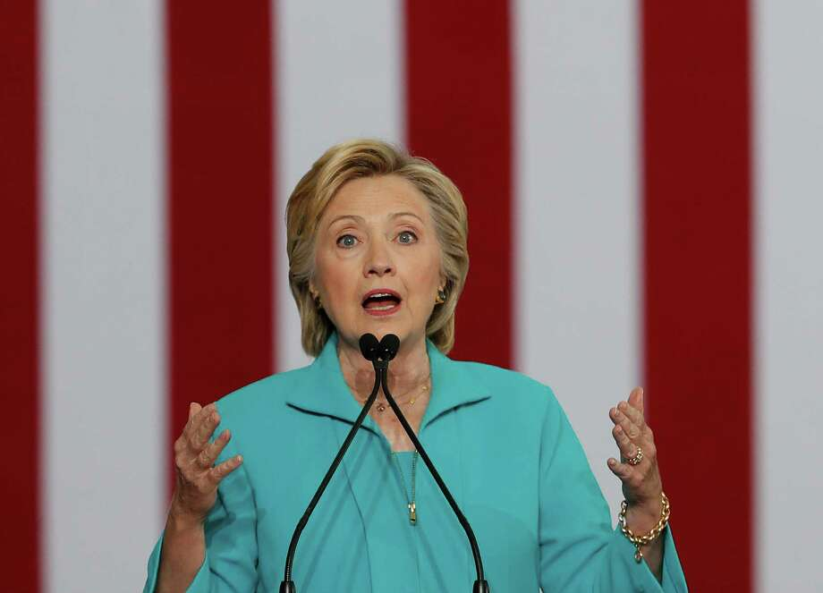 On immigration, Democratic presidential candidate Hillary Clinton shouldn't throw stones at her GOP rival. Her guilt-by-association to those with questionable track records on the issue should give voters pause. (AP Photo/Carolyn Kaster, File) Photo: Carolyn Kaster, STF / Copyright 2016 The Associated Press. All rights reserved. This material may not be published, broadcast, rewritten or redistribu