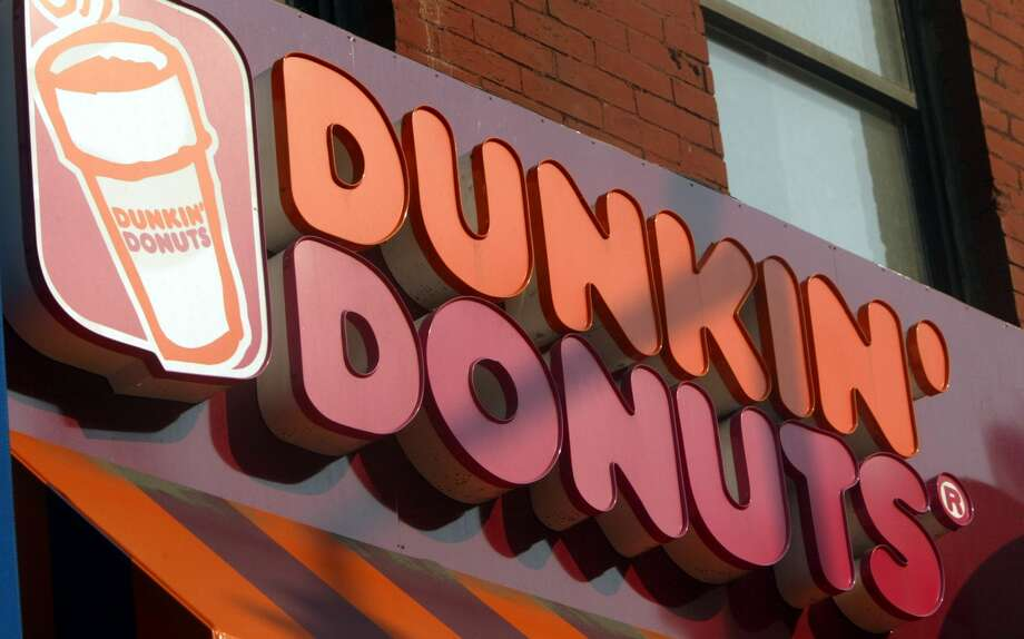 NEW YORK - MAY 13:  A Dunkin Donuts sign is seen May 13, 2004 in New York City. Dunkin Donuts plans to open 10 stores inside Wal-Mart stores within the next three months. (Photo by Mario Tama/Getty Images) Photo: Mario Tama/Getty Images