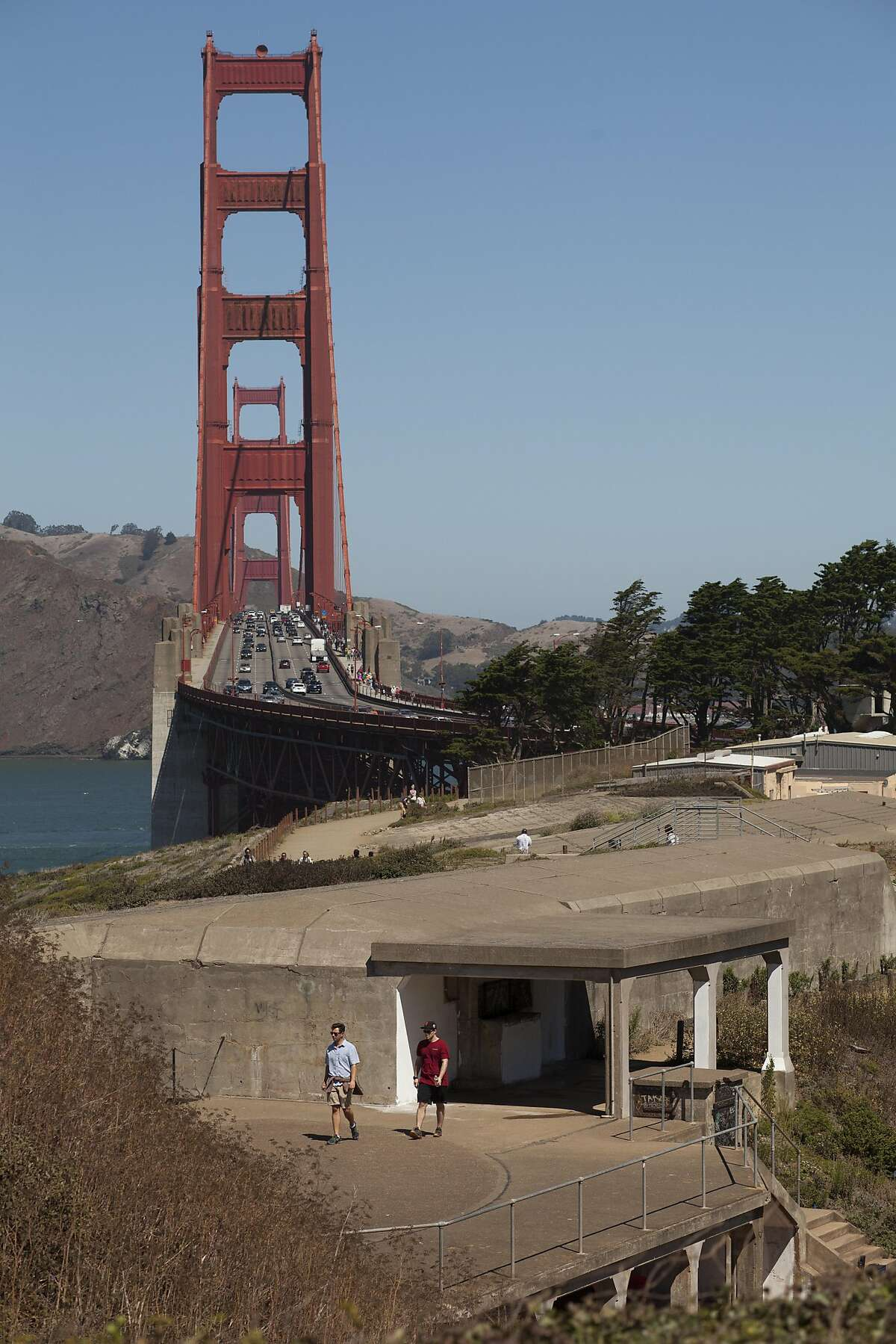 Tourist stroll over the top of Battery Marcus Miller, a partially underground, reinforced-concrete bunker, being used as a gallery space for the Home Land Security Exhibition in the Historic Military-Defense Structures in the Presidio over looking the Golden Gate bridge, in San Francisco, California, USA 30 Aug 2016. (Peter DaSilva/Special to The Chronicle)