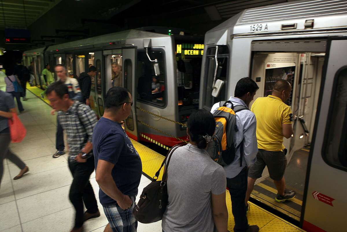 Commuters enter and exit line N Muni bus at the Van Ness subway station in San Francisco, Calif., on Thursday, October 2, 2014. Three transportation propositions are on the November ballot including Proposition B--an increase in the Muni budget to keep pace with the population growth.