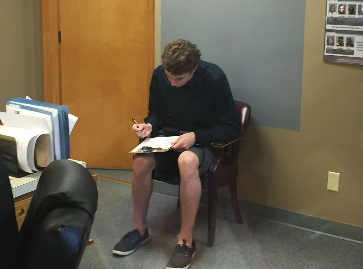 Brock Turner registers as a sex offender at the Greene County sheriff's office on Tuesday, Sept. 6, 2016, in Xenia, Ohio. The former Stanford University swimmer whose six-month sentence for sexually assaulting an unconscious woman sparked a national outcry, registered days after leaving a California jail after serving half his term. (Jarod Thrush/Dayton Daily News via AP)