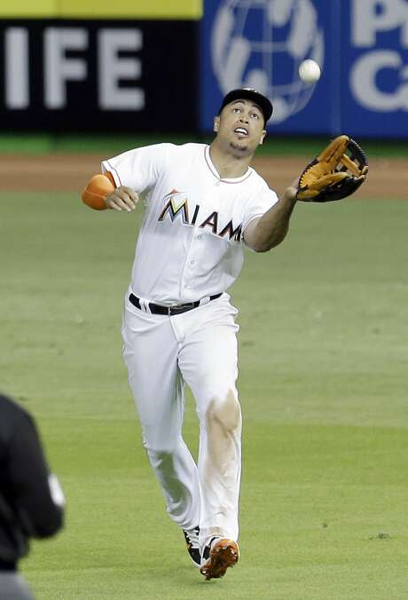 Miami Marlins right fielder Giancarlo Stanton catches a fly ball by Atlanta Braves' Mallex Smith during the ninth inning of a baseball game, Friday, April 15, 2016, in Miami. The Braves won 6-3. (AP Photo/Alan Diaz) Photo: Alan Diaz, Associated Press